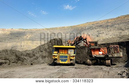 Quarry Truck Carries Coal Mined. Large Quarry Dump Truck. Transport Industry. Mining Truck Is Drivin