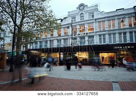 READING, UK - NOVEMBER 17, 2019: Pedestrians on the high street outside John Lewis & Partners department store on Broad Street in Reading, Berkshire, UK. M