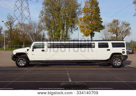 Muiden, The Netherlands - November 17, 2019: White Hummer Wedding Limousine Parked On A Public Parki