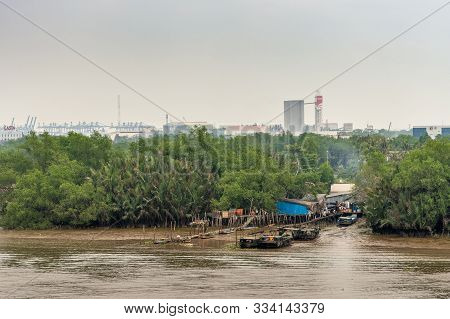 Ho Chi Minh City Vietnam - March 12, 2019: Song Sai Gon River Inlet Leading To Slums, Hidden In Gree
