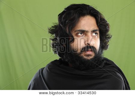 Indian young man on green
