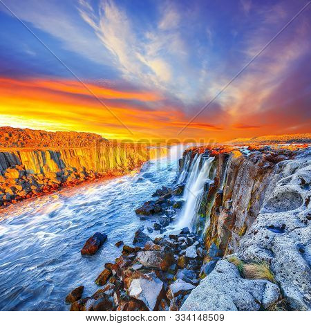Dramatic Sunset View Of Fantastic Waterfall And Cascades Of Selfoss Waterfall. Location: Vatnajokull