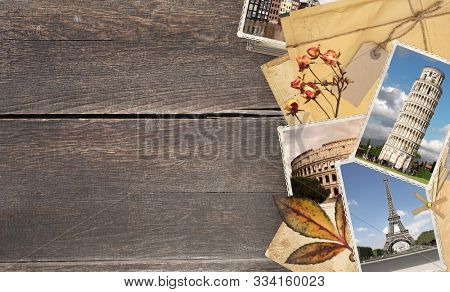 Vintage travel background with old wood planks texture, retro photos of european landmarks, envelope with label, dry rose flowers and leaf. Mock up template. Copy space for text