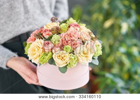 European Floral Shop. Floral Bunch In Round Box. Bouquet Of Beautiful Mixed Flowers In Woman Hand. E