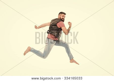 Feeling So Energetic. Active And Energetic Hipster In Photo Studio. Bearded Man Running Fast With En