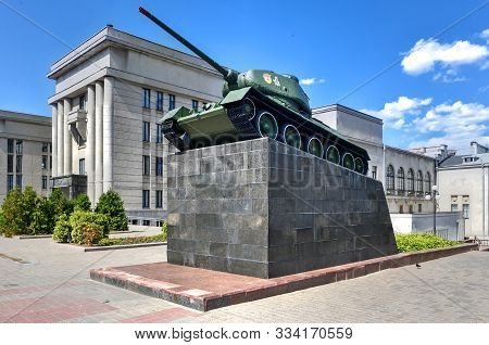 Soviet T-34/85 Tank On A Pedestal Near The Army Headquarters In Minsk, Belarus. Dedicated To The Red