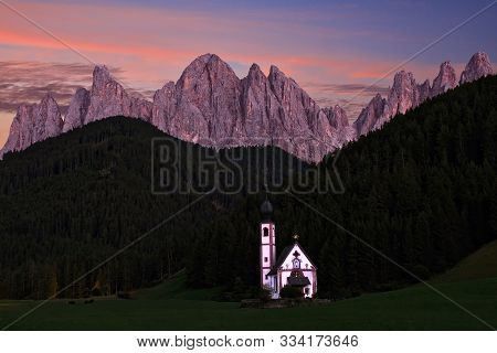 Little Pretty Old Church In Green Fiels By Scenic Mountain Ridge In Dolomites. San Giovanni Church I