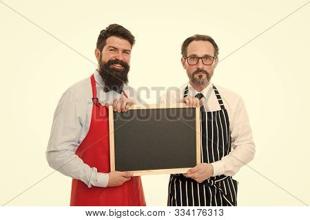 Men Bearded Bartender Or Cook In Apron Hold Blank Chalkboard. Bartender With Blackboard. Hipster Bar