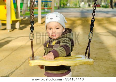 A Cute Little Boy At The Playground