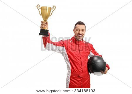 Happy winner racer raising a gold trophy and holding a helmet isolated on white background