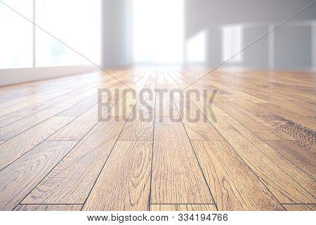 Close Up Of Wooden Floor In Bright Room Interior. 3d Rendering
