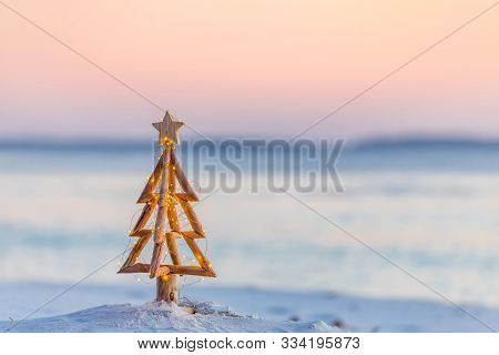 Coastal Christmas.  A Christmas Tree With Pretty Fairy Lights On The Beach In Australia With Soft Ba