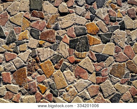 Beautiful Surface Of Multicolored Natural Stones. Mosaic Pattern Of Yellow, Beige, Red, Black, Gray,