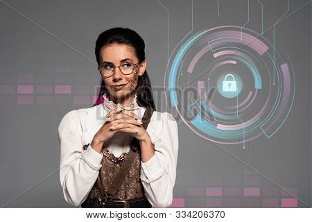 Pensive Steampunk Woman Looking Away With Clenched Hands Isolated On Grey