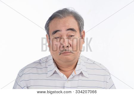 Weary Asian Man Is Exhausted. He Is Tired Of Listening His Wife Chatting