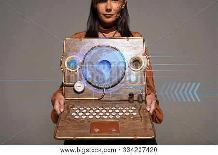 Cropped View Of Steampunk Woman In Top Hat With Goggles Showing Vintage Laptop With Digital Map Isol