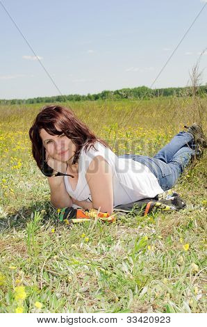 Woman Resting On The Grass