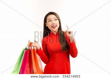 Vietnamese Girl With Ao Dai And Shopping Bag, White Isolated Background