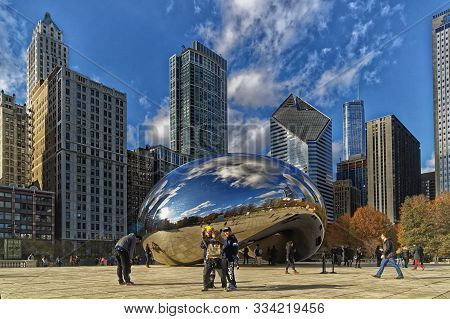 Chicago, Illinois-december 2,2015: Cloud Gate (the Bean) At Millennium Park With Chicago Skyline In