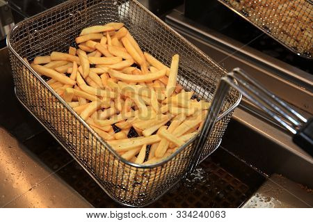 French Fries In Fry Steel Basket On Street Market In Germany