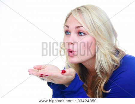 Woman Blowing Air Over Hands.
