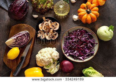 Top View Of Fresh Vegetables On Rustic Table