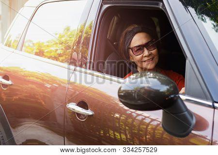 Happy Senior Woman In Sunglasses Driving A Car.