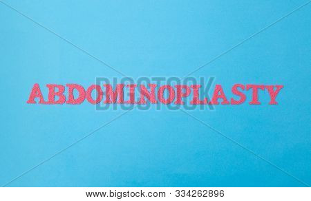 Word Abdominoplasty In Red Letters On A Blue Background. The Concept Of Correction Of Fat Folds And