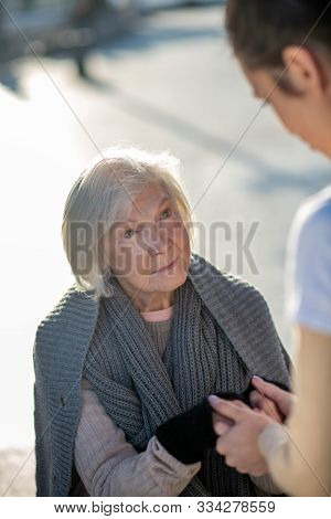 Aged Homeless Woman Feeling Happy While Talking To Volunteer