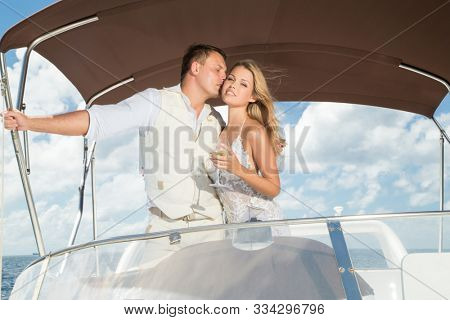 couple relaxing on a yacht at sea