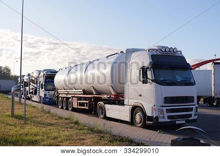 Trucks Transporting Various Goods. Photo Shows A Tanker And A Truck For Transporting Passenger Cars.