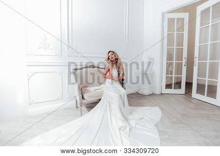 Beautiful Woman 30-35 Years Old In Stage Makeup And Long White Evening Wedding Dress.