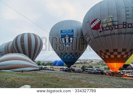 Goreme, Cappadocia, Turkey - May 08, 2014: Hot Air Balloons Flying Tour. Landscape Sunrice Cappadoci
