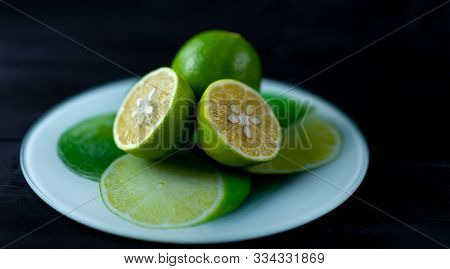 Lime On A Tray And Wooden Background.lime On A Tray And Wooden Background