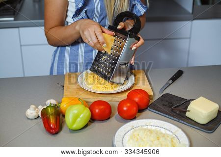 Cheese Grated By Grating Next To Vegetables.
