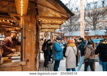 PARIS, FRANCE - November 17, 2019:  Tourists at the Christmas Market in the Tuileries Garden in Paris
