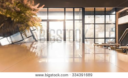 Wood Table Top With Blurred Brighten Sunshine From Glass Doors In Coffee Shop Or Cafe, Restaurant Ba