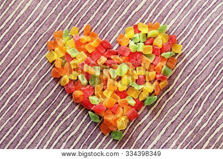 Heart Made Of Dried Candied Fruits On Table Background. Colorful Candied Fruits Succade Assorted Can