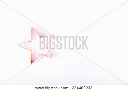 Flatlay With Star Copper Cookie Cutter On White Sparkling Background. Holiday, Christmas And New Yea