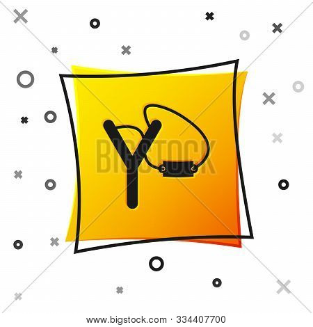 Black Slingshot Icon Isolated On White Background. Yellow Square Button. Vector Illustration