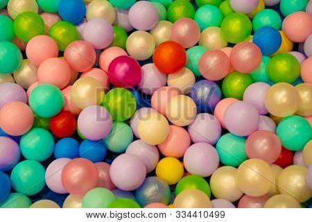 Colorful Child Balls. Multi-colored Plastic Balls. Achildrens Playroom. Background Texture Of Multi-