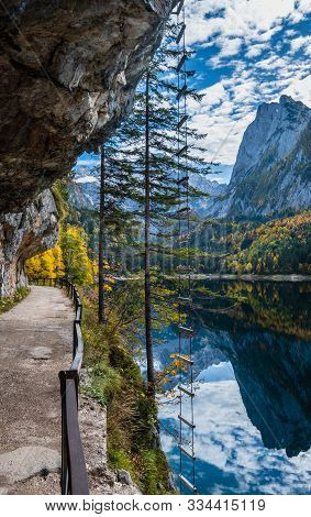 Autumn Alpine View. Peaceful Mountain Lake With Clear Transparent Water And Reflections And Ferrata