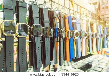 Many Modern Wrist Watchs Hang On To Show And Inexpensive For Sale In Local Market. Selective Focus.