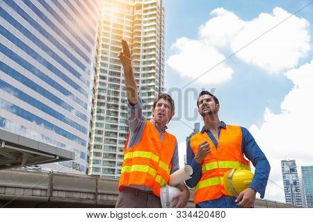 Engineer Guy Or Foreman Working With Worker Or Blue Collar Worker Together By Site Survey. Boss Engi