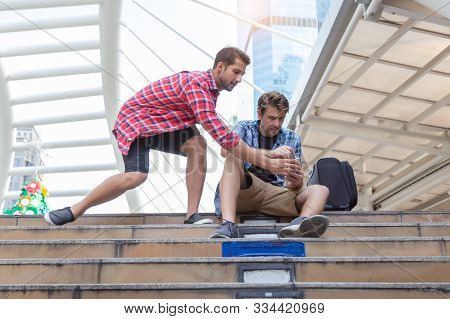 Thief Guy, Bandit Guy Grasping Money From Tourist Man While Traveler Man Counting Money And Sitting