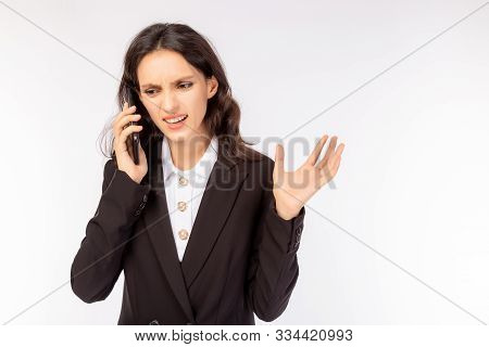 Business Woman Gets Disagrees, Angry, Unsatisfied And Unhappy Her Customer Or Boss. White Collar Wor