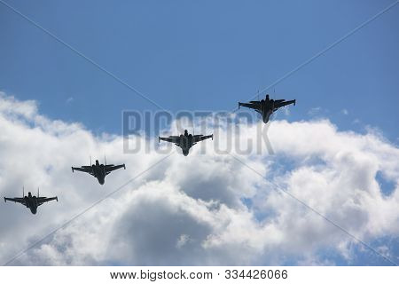 Four Destroyers On Airshow In White Clouds. Fast Warplane Jets Designed For Attacking Other Armed Ex