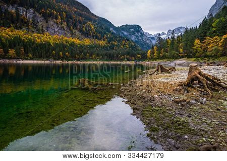 Vorderer Gosausee Lake, Upper Austria. Colorful Autumn Alpine View Of Mountain Lake With Clear Trans