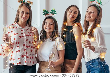 Group Of Young Women Celebrating Christmas, New Year