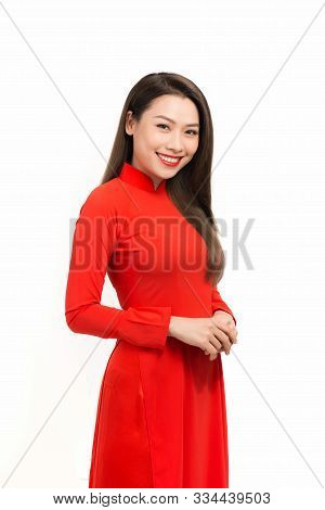 Lunar New Year Celebrations. Portrait Of Vietnamese Woman Dress In Ao Dai